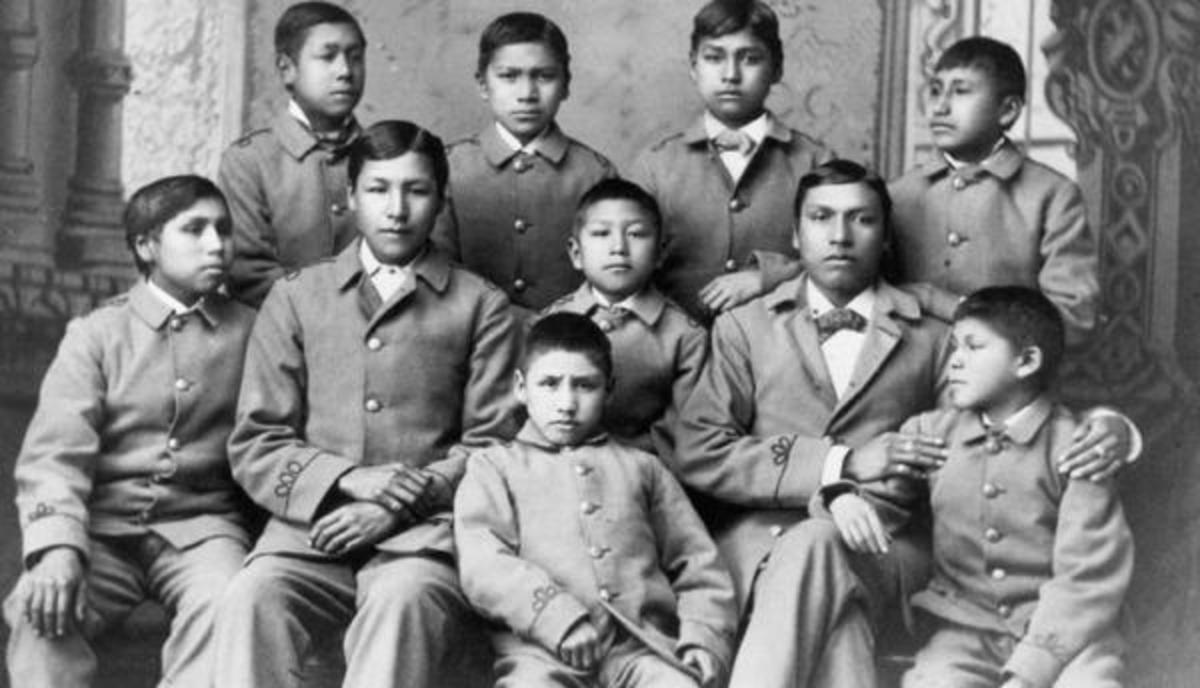 A group of Omaha American Indian students in their cadet uniforms at the militaristic Carlisle Indian Industrial School, circa 1880.
