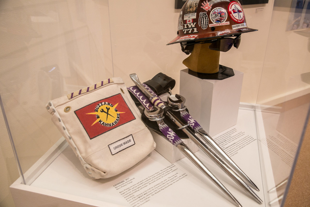 A hardhat, ironworking tools and a bag for bolts is among the exhibit at the Iroquois Indian Museum highlighting Iroquois ironworkers. Alex Hamer
