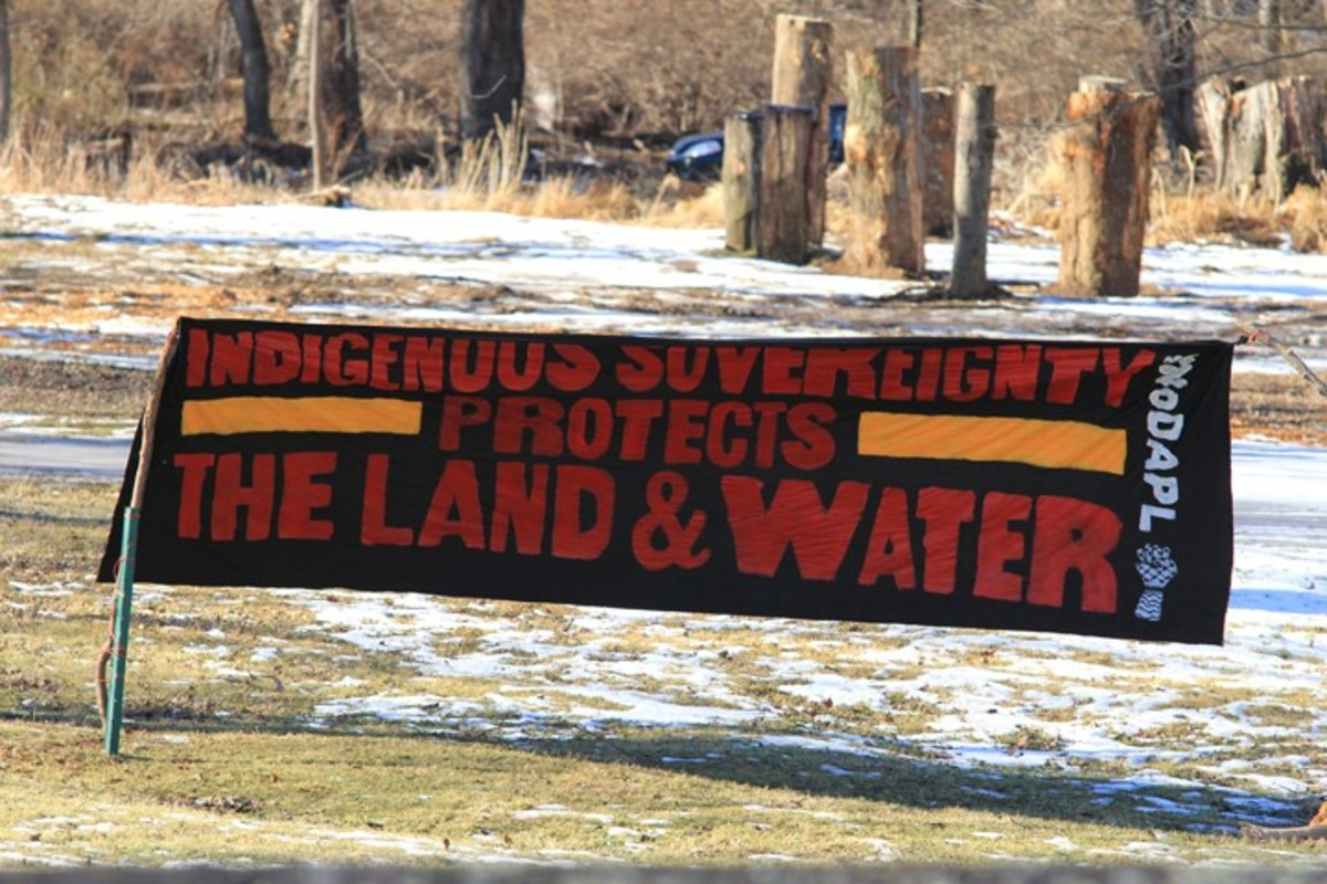 Sign that sits at the main entrance of the camp - Photo Cliff Matias