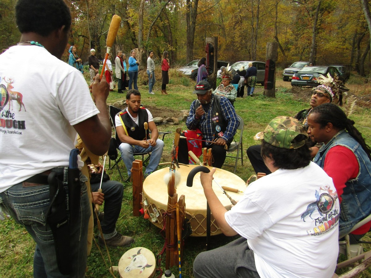 Members of the Ramapough Nations Singers preparing for a ceremony - Photo Cliff Matias