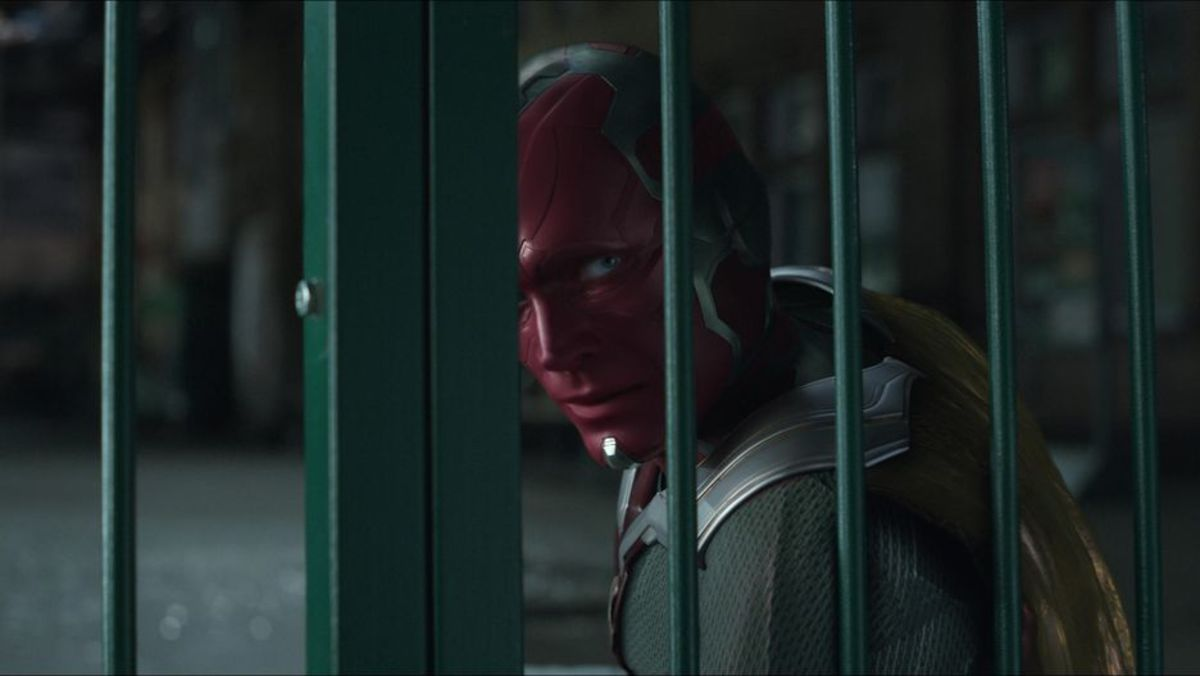 The Vision has no idea his forehead -- which hosts the Mind Stone --is about to be ripped out by Thanos.