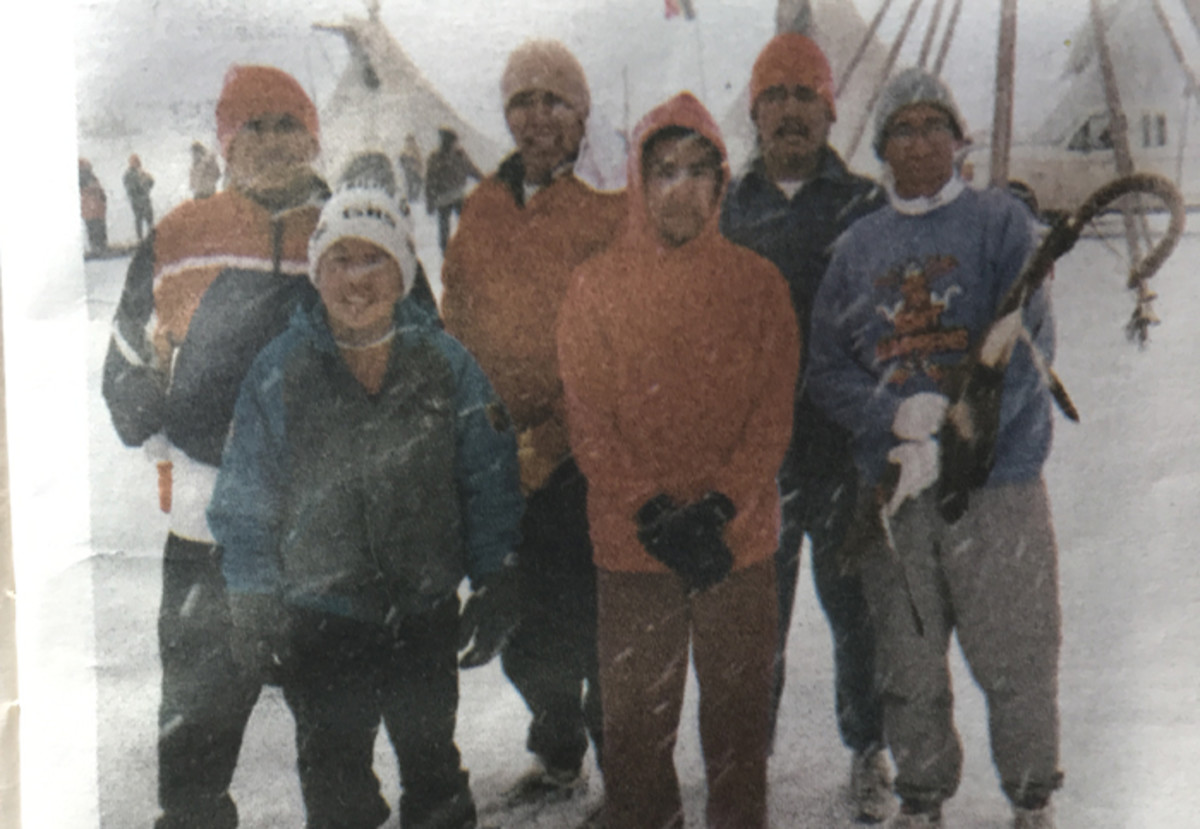Newspaper clipping of Sacred Hoop runners at the American Indian Movement's Wounded Knee Memorial in 1998.