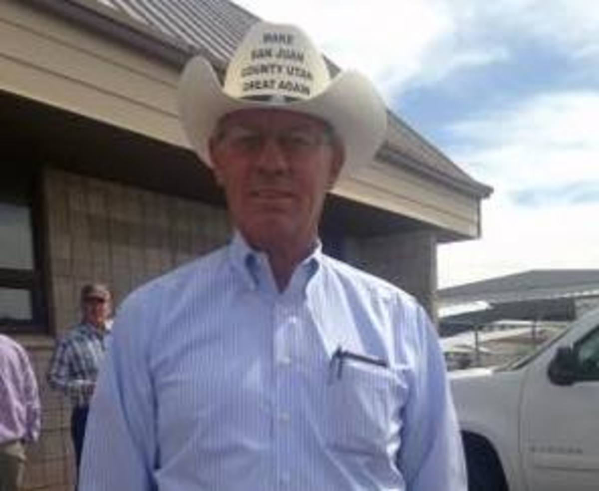 """Opponents of Bears Ears' designation as a national monument sported cowboy hats saying, """"Make San Juan County Utah Great Again."""""""