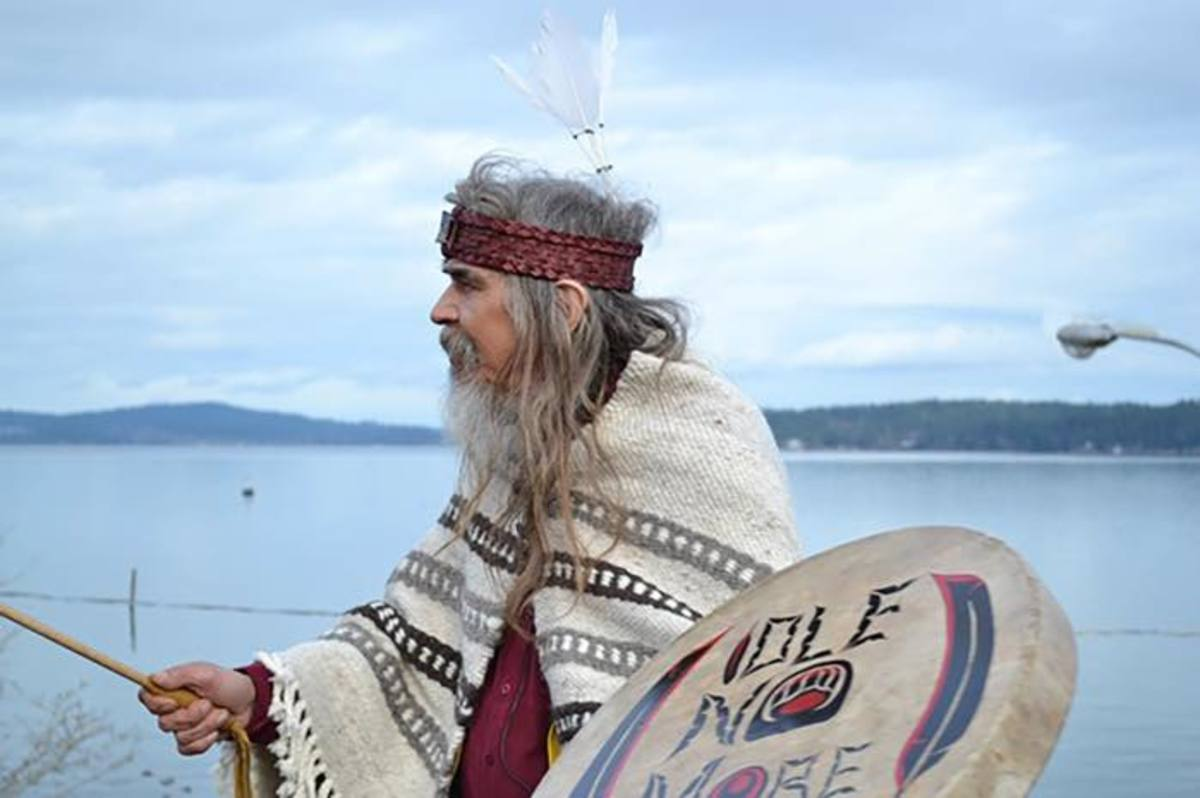 Chief Beau Dick drumming on his walk to Victoria in 2013.