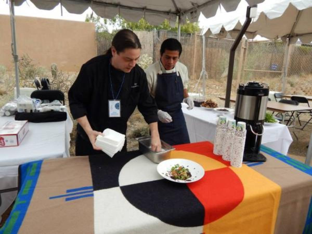 Sioux Chef Sean Sherman, left, and Neftali Duran, an Oaxacan chef, plate an Ojibwe salad during a cooking demonstration.