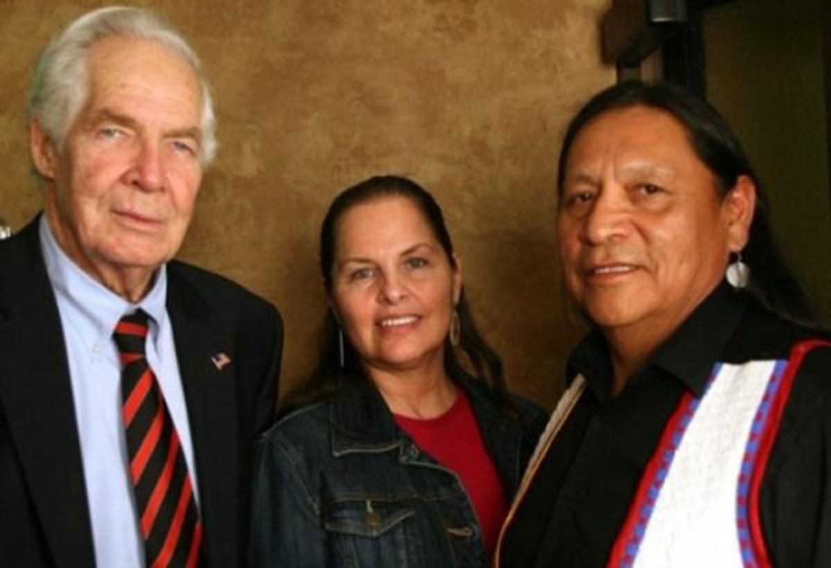 Cynthia Lindquist, Dakota, president of Cankdeska Cikana Community College (center) brought together Dr. Donald Lindberg, director of the National Medical Library (left) with Albert Red Bear, Jr., and eight other respected medicine men. (By Mary Annette Pember)