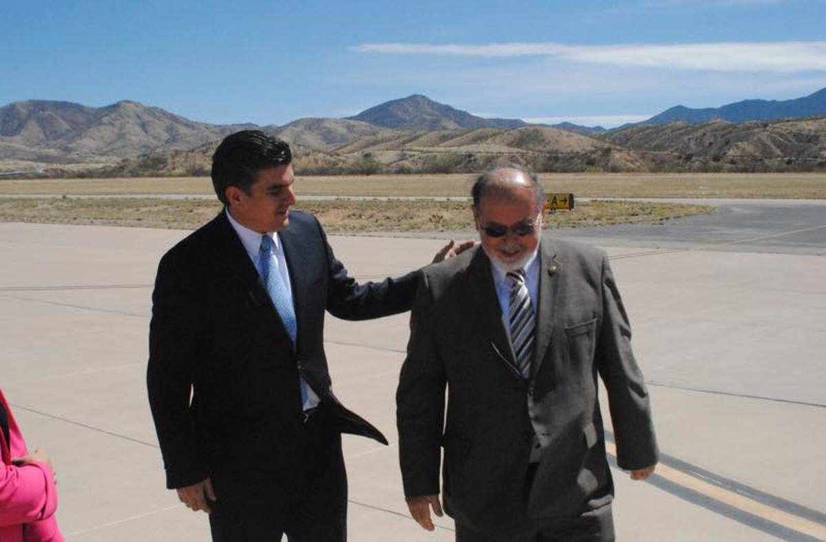 Nogales, Arizona, Mayor John Doyle (right) meets with Sonoran Secretary of State Miguel Pompa on the tarmac of the Nogales Airport.