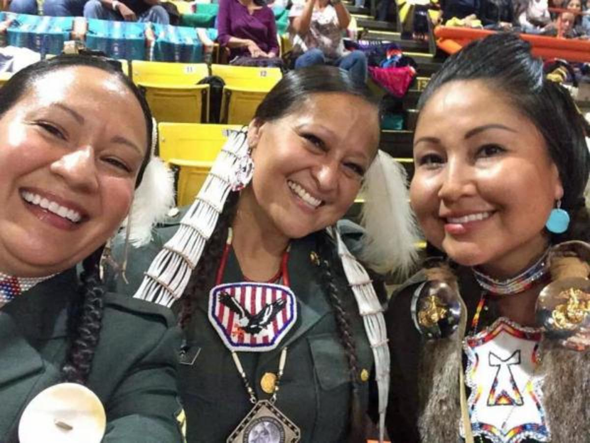 The Lakota Women Warriors at the 2014 Black Hills Pow Wow. Left to right: Kella With Horn, Lisa Jendry and Brenda White Bull