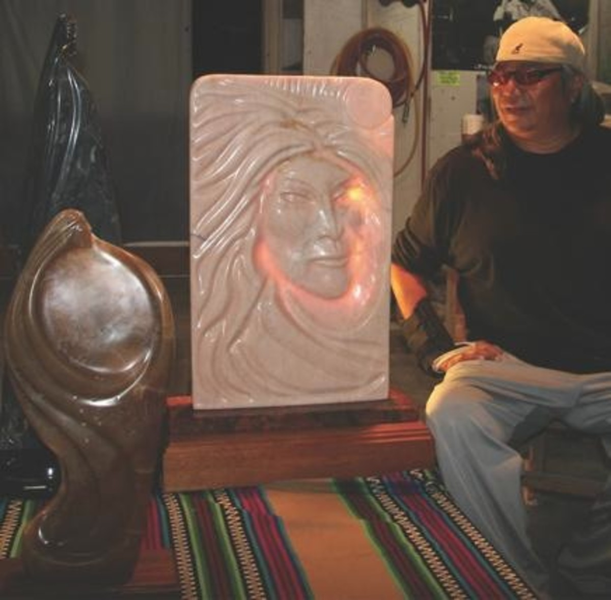Presley LaFountain in studio with an alabaster sculpture