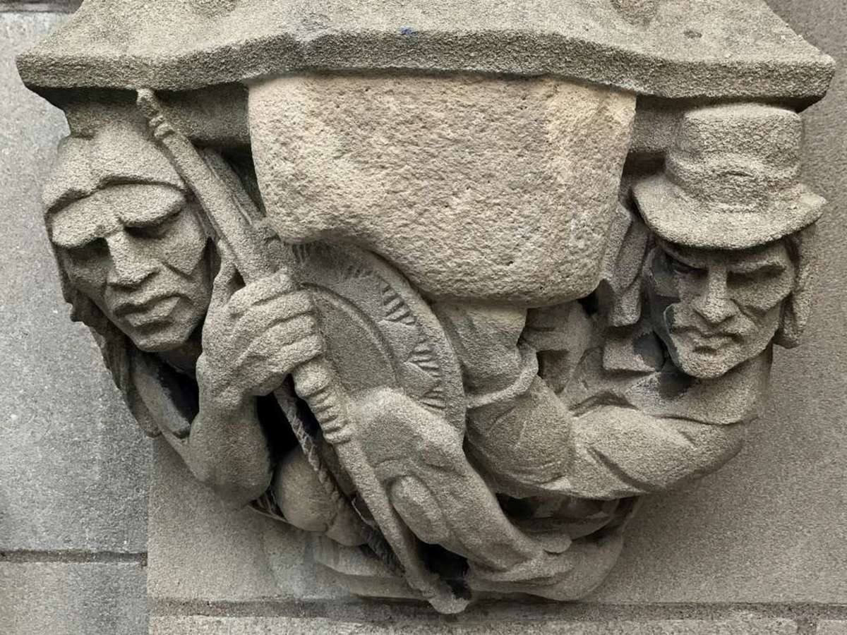 A stone carving of a white Puritan aiming a musket at a Native on the Yale University campus in New Haven, Connecticut, will be relocated, not remove, Yale officials said.