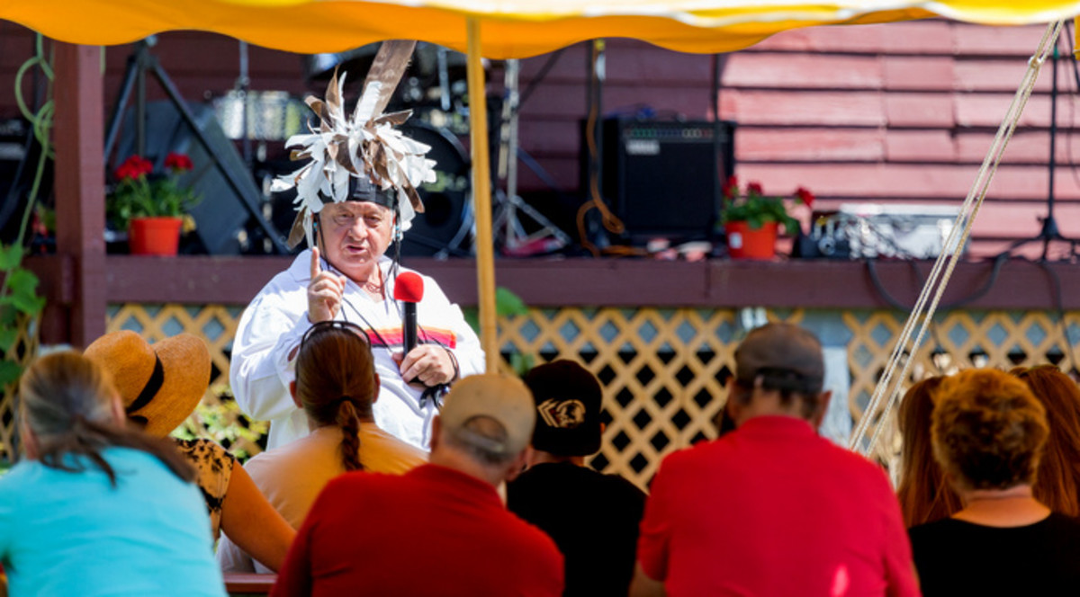 Tom Porter giving the opening thanksgiving address to attendees at the Mohawk Strawberry festival at the Kanastioraheke Mohawk community.