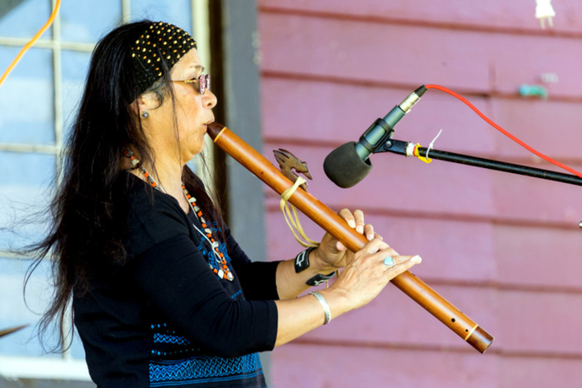 Flutist Migon Geli Performing for the crowd.