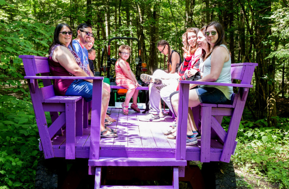 Guests enjoying a wagon ride through the woods during the the Mohawk Strawberry festival in the Kanastioraheke Mohawk community.