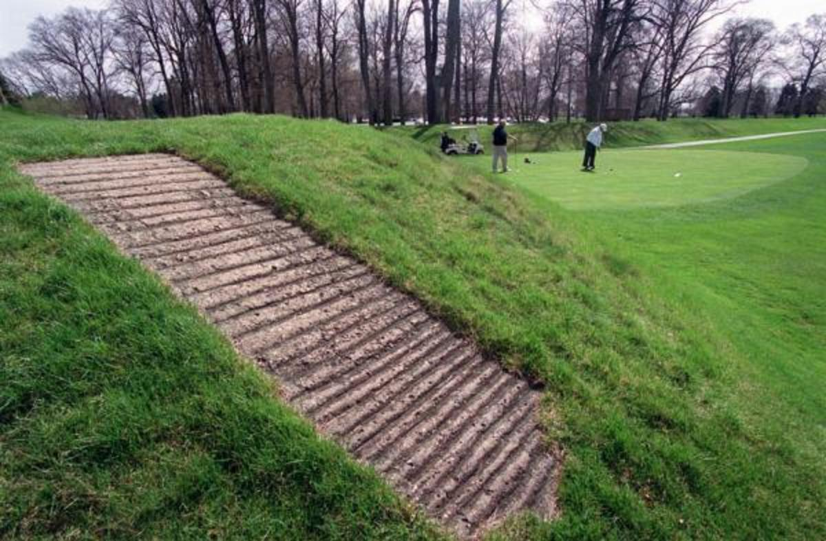 A concrete walkway allows golfers access to the top of an Indigenous mound at Moundbuilders Country Club in Newark, Ohio. The mound, shown here in 2000, is part of the Newark Earthworks, which are being considered for nomination as a UNESCO World Heritage Site. The lack of public access, however, could derail the nomination. (Photo by Jeff Adkins, The Columbus Dispatch, via AP)
