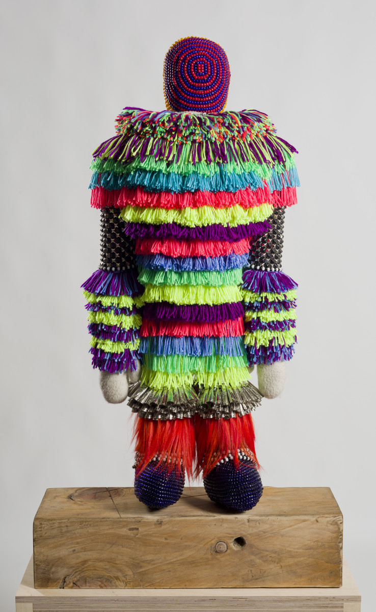 The Clown, 2014. Wool, deer rawhide, glass beads, quartz crystals, tin cones, steel studs, acrylic yarn, repurposed wood block, dyed Mongolian goat fur - artist Jeffrey Gibson. Courtesy of the artist Jeffrey Gibson and MARC STRAUS Gallery