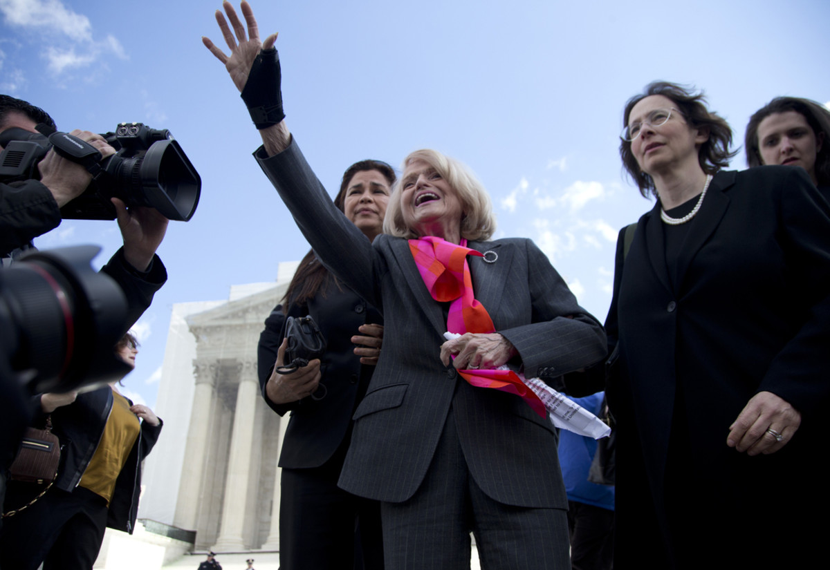 Plaintiff Edith Windsor,of New York, waves to supporters in front of the Supreme Court in Washington on Wednesday, after the court heard arguments on her Defense of Marriage Act (DOMA) case.