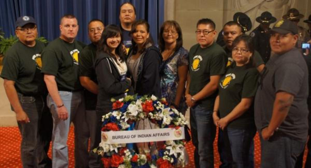 Sgt. Curley's Fellow Officers and Family: Slain Navajo police Sgt. Darrell Curley's fellow Navajo police officers from the Tuba City district stand with Sgt. Curley's wife Pauline Curley, and children Arielle Curley, Bronte Curley, and Derrick Curley following the Department of the Interior Law Enforcement Memorial Ceremony, May 14, 2012.