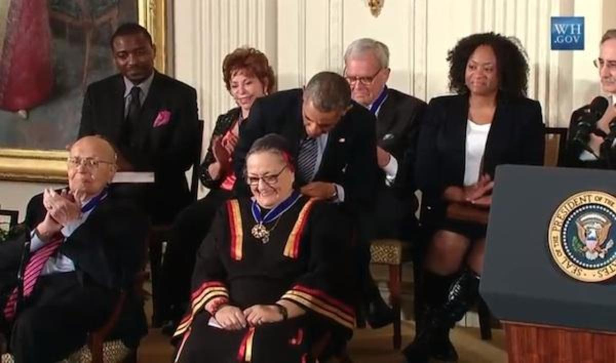 President Barack Obama places the Medal of Freedom, the U.S.'s highest civilian honor, around the neck of Suzan Shown Harjo on November 24, 2014.