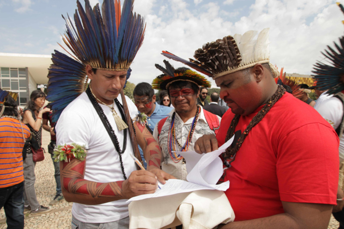 Protest outside Congress in Brasilia against threats to indigenous land like illegal logging