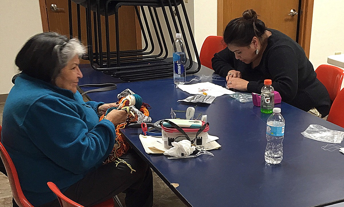 Members of the Ho-Chunk Nation in Tomah, Wisconsin, join a weekly gathering to practice traditional skills and help to make beaded lanyards for Super Bowl LII. Photo: Josephine Lee