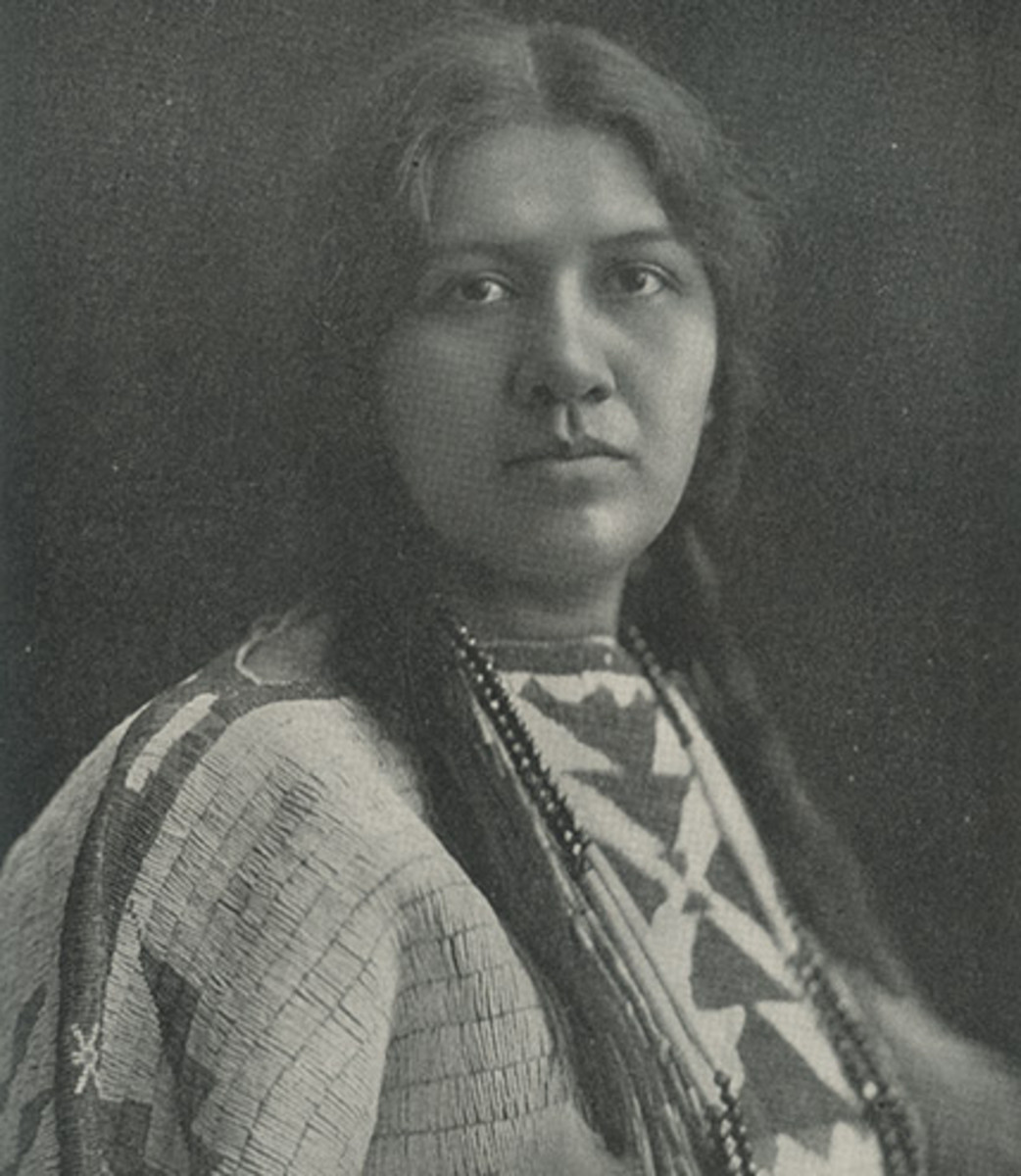 """Angel De Cora is seen here in the portrait that accompanies her essay """"Native Indian Art"""" in Proceedings of the First Conference of the Society of American Indians, 1911. Her buckskin dress is Great Plains-style, not of her own Winnebago culture. (Courtesy Gustave Hensel/Carlisle Indian Industrial School/1907)"""