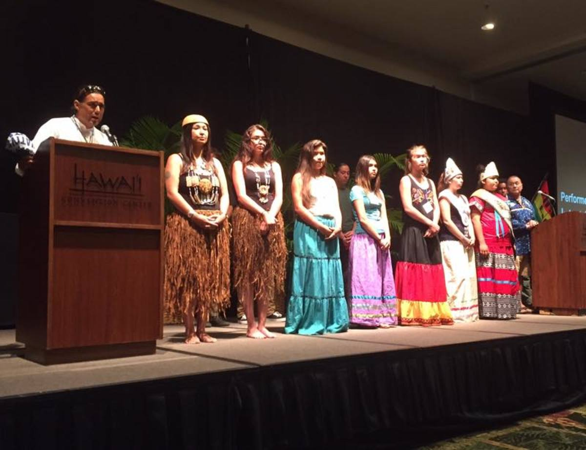 Marc Chavez, InterTribal Youth Founder, introduces Southern California Bird Songs and Dancers at the Hawaiian Convention Center as part of the Hokulea Malama Honua Summit and Fair, which also kicked off the Word Youth Congress.