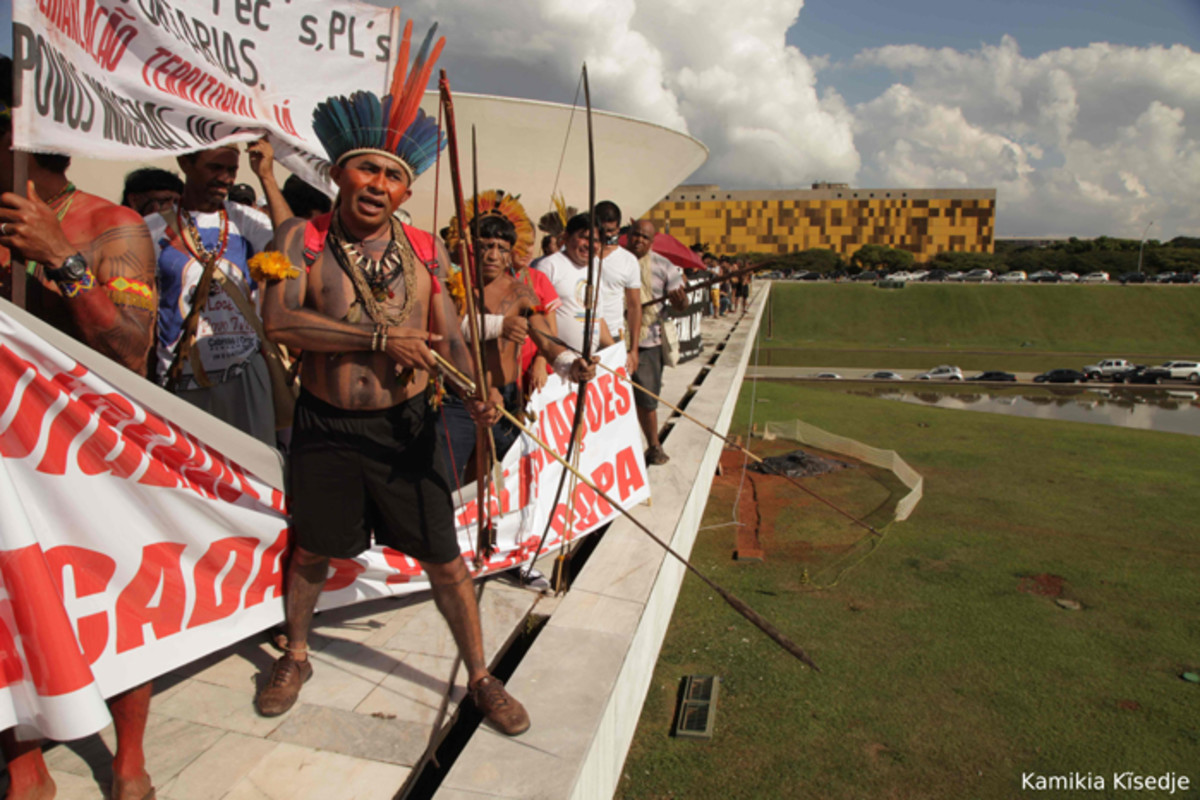 Protest outside Congress in Brasilia against threats to indigenous land like illegal logging1