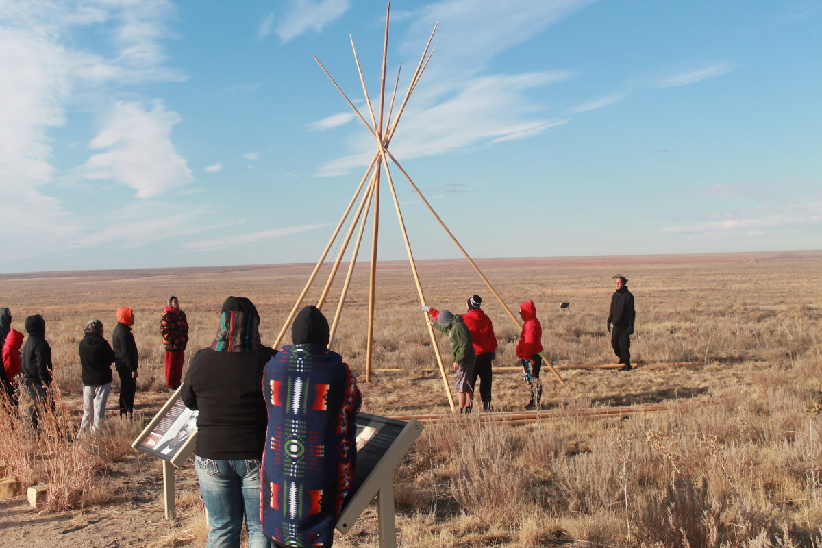 Young Cheyenne and Arapaho youth set up a tipi on the Sand Creek Massacre site. (Courtesy NPS/Shawn Gillette)