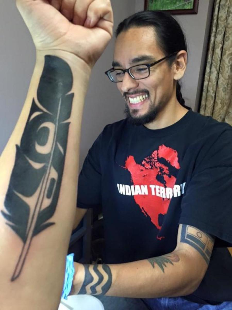 """Tlingit tattoo artist Nahaan featured alongside """"Healing Feather,"""" a one-of-a-kind eagle feather tattoo he made for Jaime Davis (Nisga'a) in 2015."""
