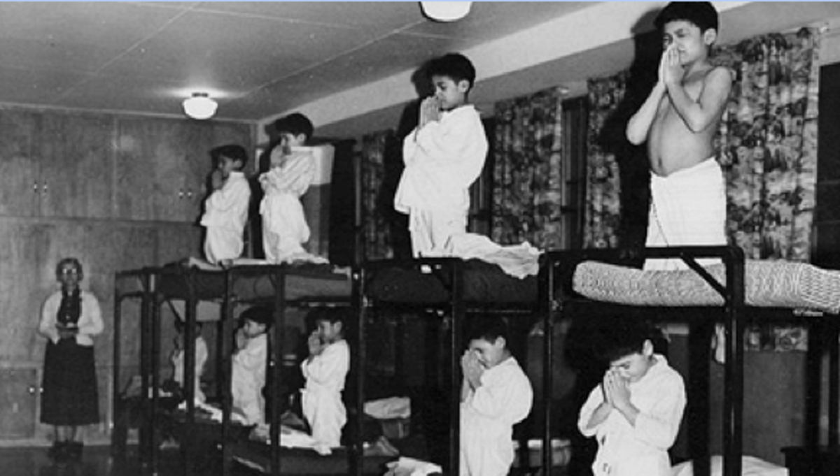 Residential school children students in a typical dormitory.