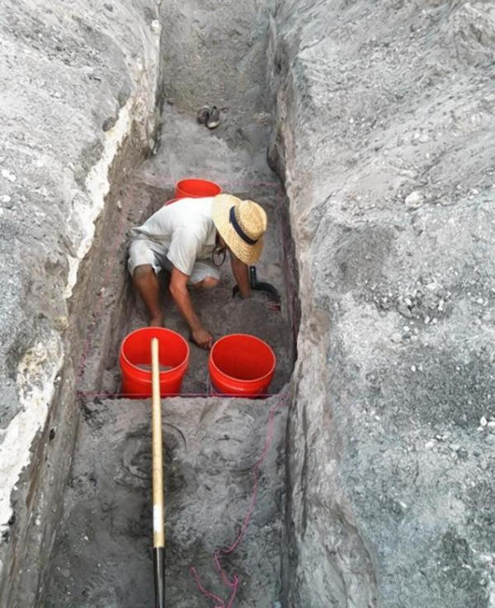 Workers show the location along Pine Island Road in Davies, Florida, where archaeologists discovered the body of a 2,000-year-old skeleton just before Christmas.