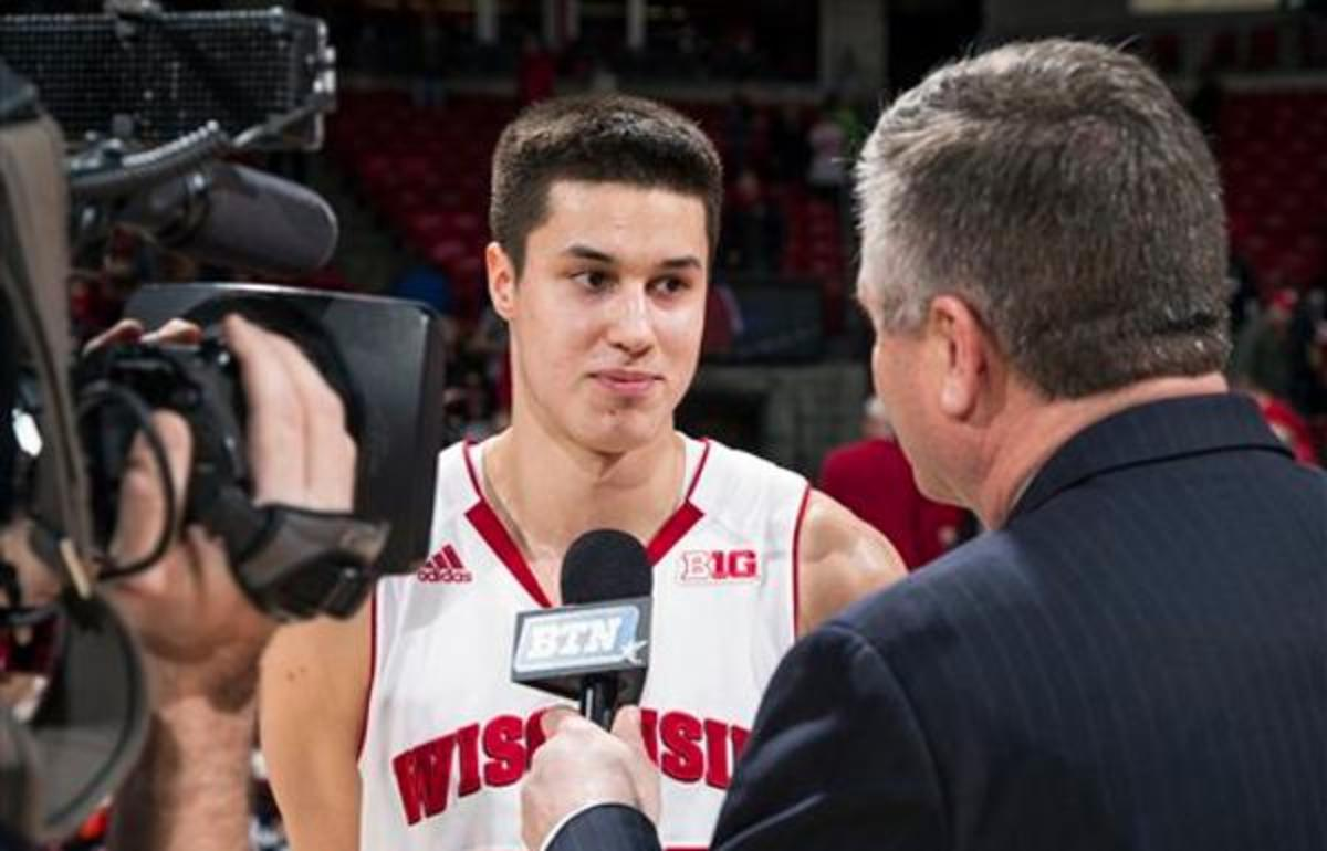 Wisconsin Badgers guard Bronson Koenig is interviewed by Big Ten Network reporter Jay Wilson after an NCAA college basketball game against the Indiana Hoosiers Tuesday, February 3, 2015, in Madison, Wis. The Badgers won 92-78. (AP Photo/David Stluka)