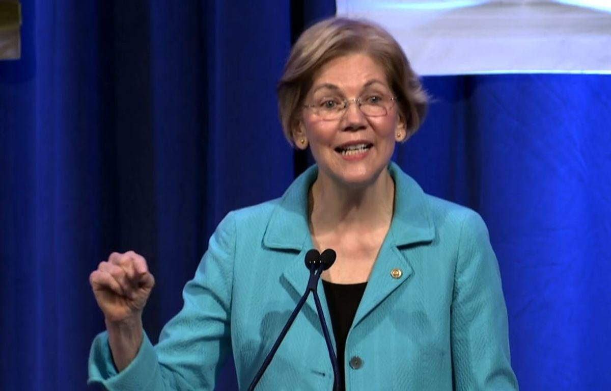 Senator Elizabeth Warren shared remarks at the NCAI Executive Winter Session amidst a room filled with tribal leaders. She condemned the use of Pocahontas as a slur and spoke of her own heritage as a way to commit to Indian Country. She received a standing ovation