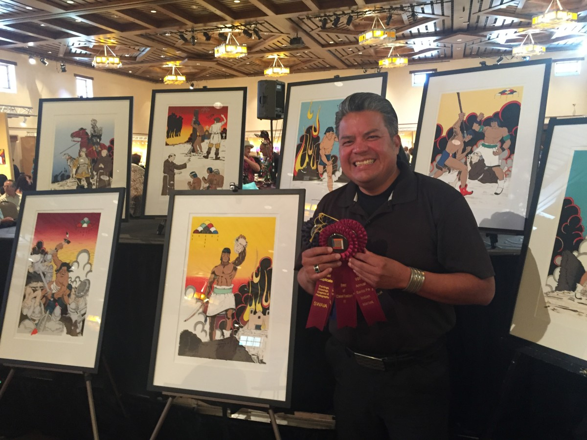 Jay Garcia holds ribbons for his award-winning work