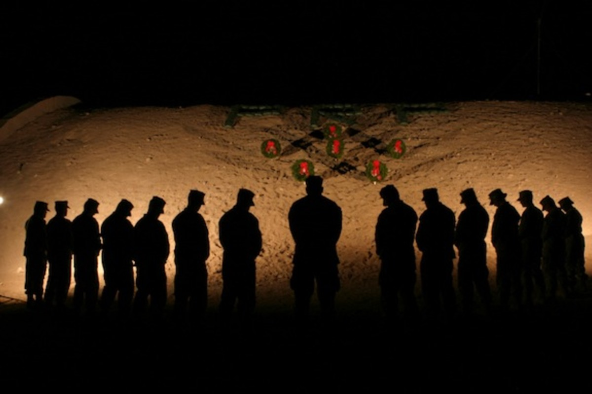 U.S. Marines bowing their heads in silence in honor of fallen comrades