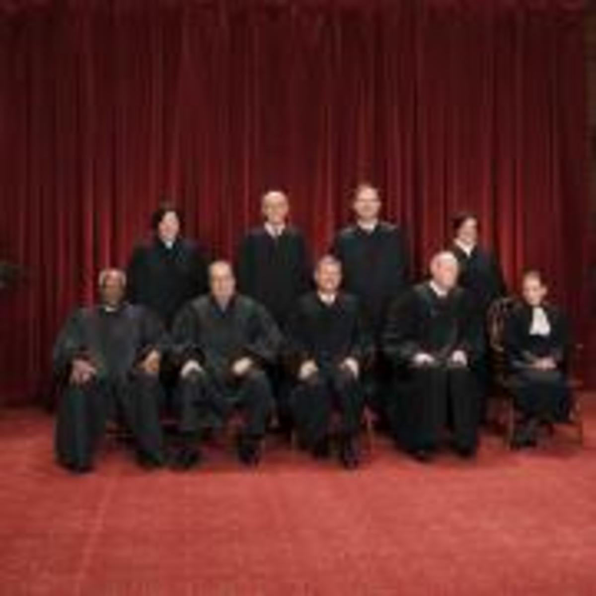 In this Oct. 8, 2010, photo, the justices of the U.S. Supreme Court gather for a group portrait at the Supreme Court Building in Washington. Seated from left to right are: Associate Justice Clarence Thomas, Associate Justice Antonin Scalia, Chief Justice John G. Roberts, Associate Justice Anthony M. Kennedy, Associate Justice Ruth Bader Ginsburg. Standing, from left are: Associate Justice Sonia Sotomayor, Associate Justice Stephen Breyer, Associate Justice Samuel Alito Jr., and Associate Justice Elena Kagan.