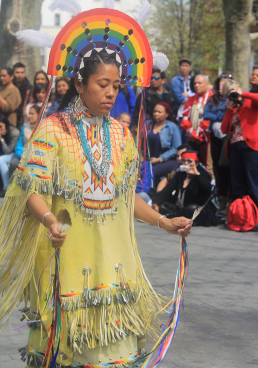 Gia Watson, who is Apache from Arizona but now resides in Brooklyn, shares the Apache Rainbow Dance with the audience as part of an event held April 23 to share indigenous culture with the local community.