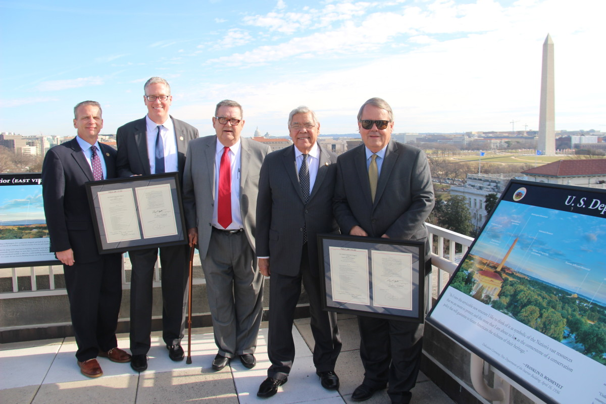 Among those honored standing on the exterior patio at the DOI. (left to right) Brian McClain (Choctaw), Choctaw Nation Executive Director Stephen Greetham, Chickasaw Nation General Counsel Bob Rabon, outside general counsel to Chickasaw and Choctaw Nations Neal McCaleb (Chickasaw), Chickasaw Nation Ambassador At-Large Judge Michael Burrage (Choctaw), outside general counsel to Chickasaw and Choctaw Nations. - Photo Vincent Schilling