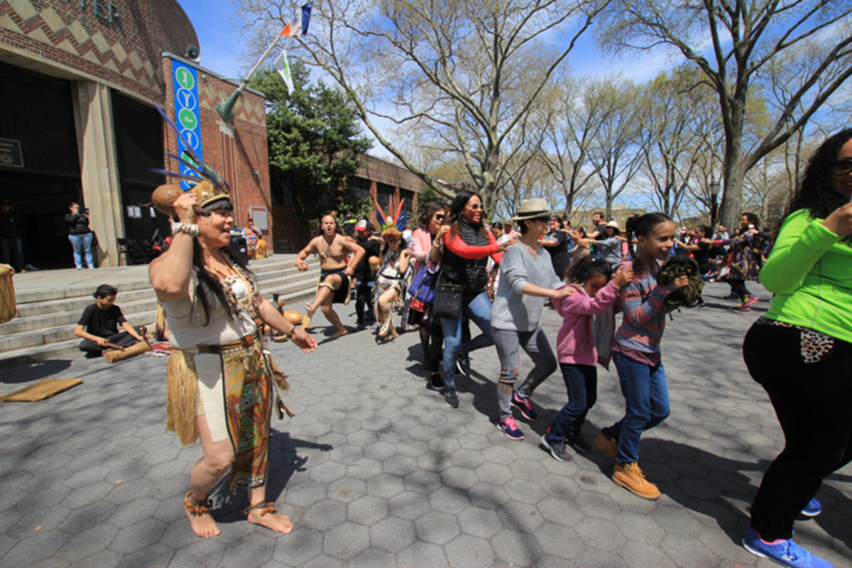 Taino dancers doing a friendship dance with members of the community as part of an event held April 23 to share indigenous culture with the local community.