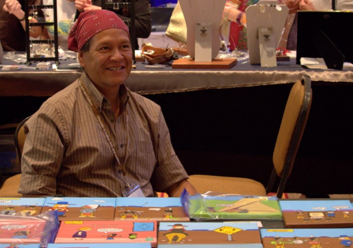 Well-known Indian country cartoonist Ricard Cate' Kewa (Santo Domingo) at his table at the Native Treasures: Indian Arts Festival.