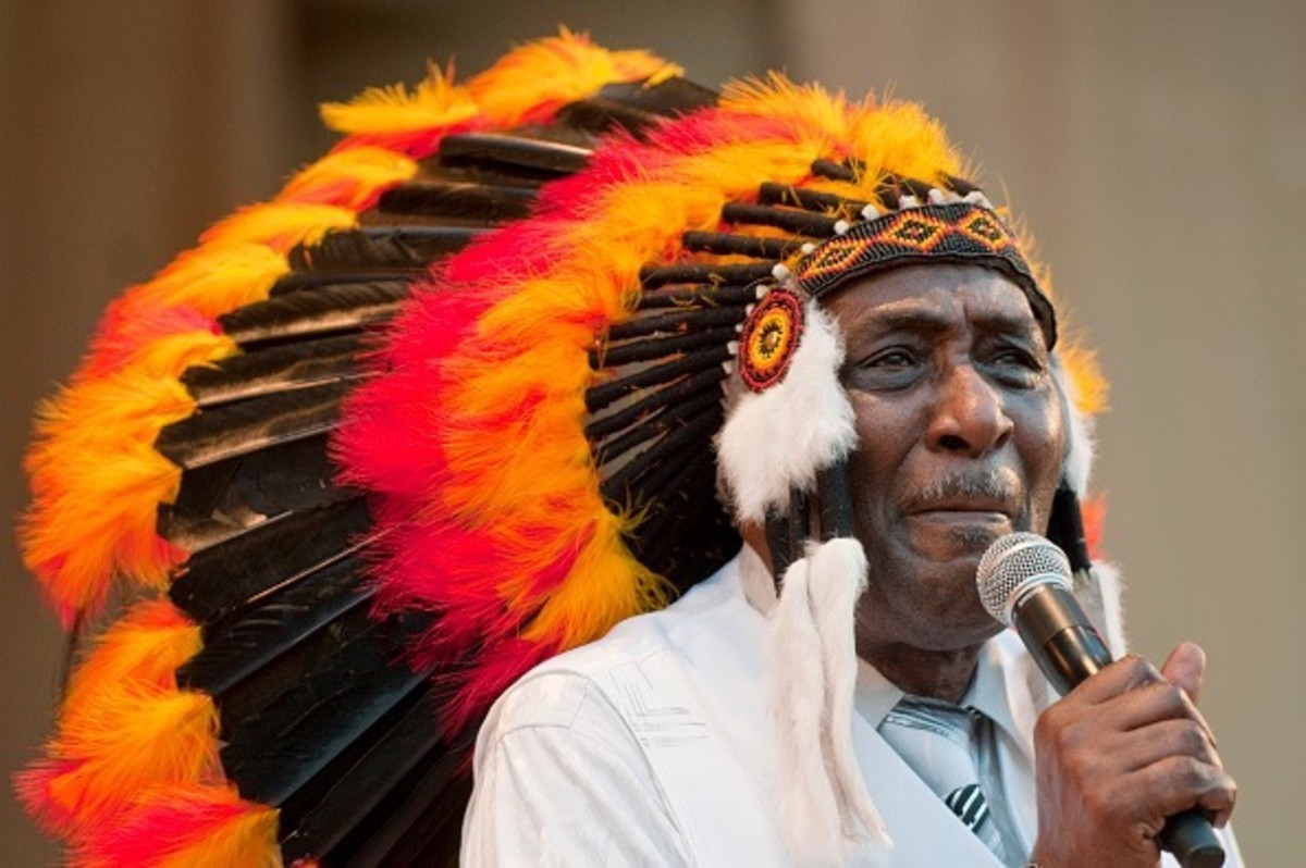 American Blues musician Eddy 'The Chief' Clearwater (born Edward Harrington) wears a headdress as he leads his West Side Strut band during a performance at the 25th Annual Chicago Blues Festival on Grant Park's Petrillo Music Shell, Chicago, Illinois, June 6, 2008.