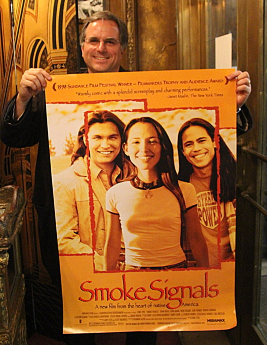 Peter Kirkpatrick, co-organizer of Film Festival, hold a poster of 'Smoke Signals.' Photo Vincent Schilling