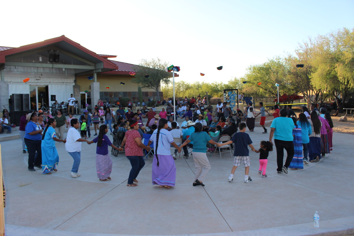 Participants sing traditional songs and dance at the 10th Anniversary of the Tohono O'odham Nation Museum and Cultural Center in Topowa, Arizona.
