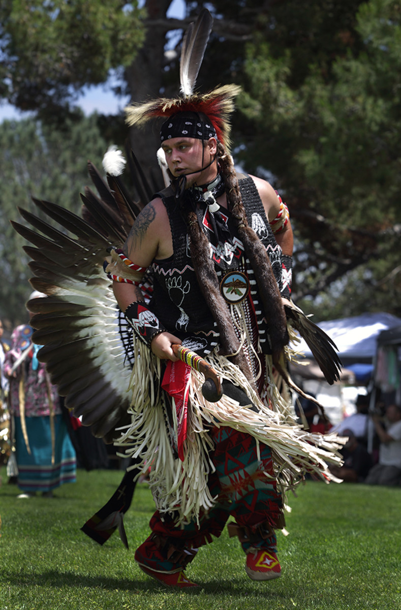 Northern traditional dancer Kale Flores, Pechanga Band of Luiseño Indian, dances during an inter-tribal. Diego James Robles
