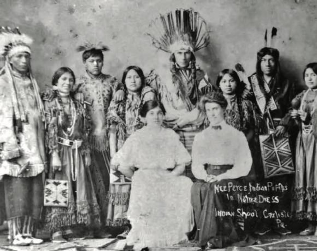 """JoAnn Kauffman, Lizzie Hayes, fourth from left as she entered Carlisle Indian School, was immersed in white culture. """"In addition to reading, writing and arithmetic, they also farmed out their students to houses—as maids and cooks and repairmen,"""" JoAnn says."""
