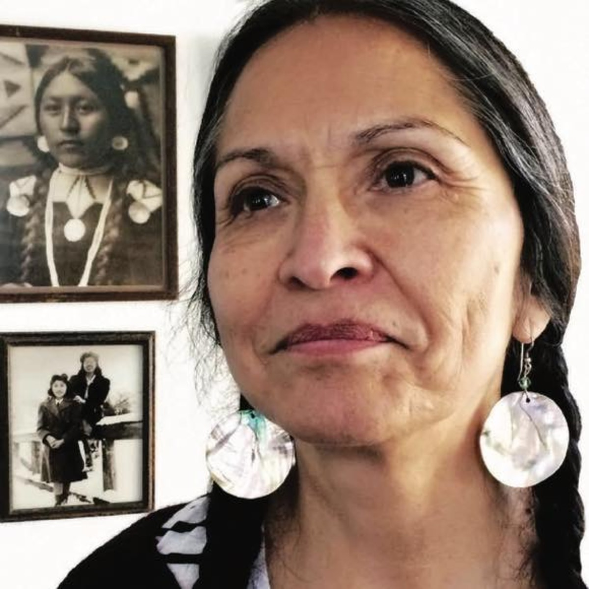 """JoAnn Kauffman, """"I grew up understanding that I was a part of the Nez Perce Tribe,"""" Kauffman says, surrounded by pictures of her ancestors in Kamiah."""