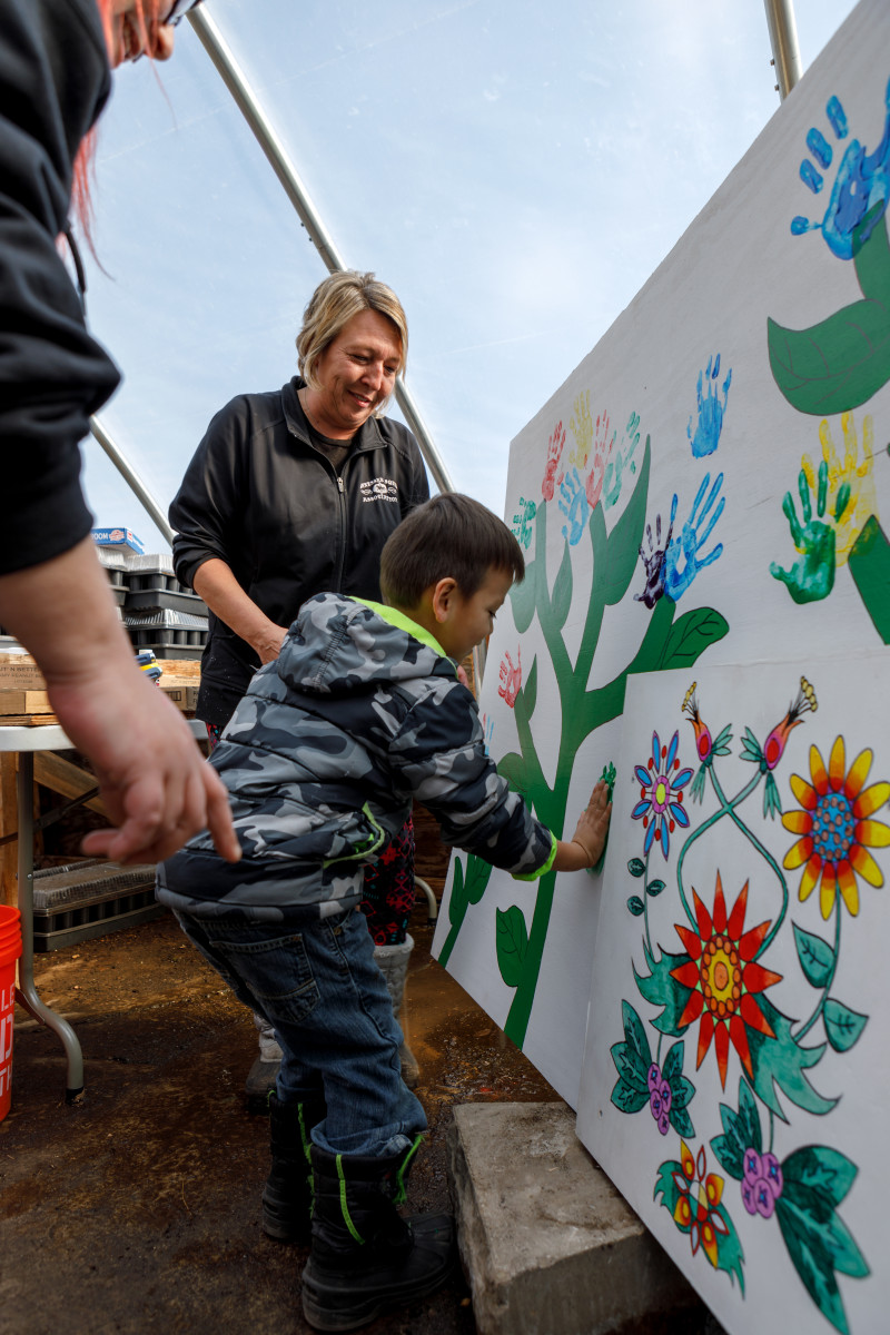 Youngsters from the Mille Lacs Ojibwe helped to paint murals and learned about planting at the Mino-Miijim greenhouse. Courtesy Steffenhagen Photography - Super Bowl Host Committee