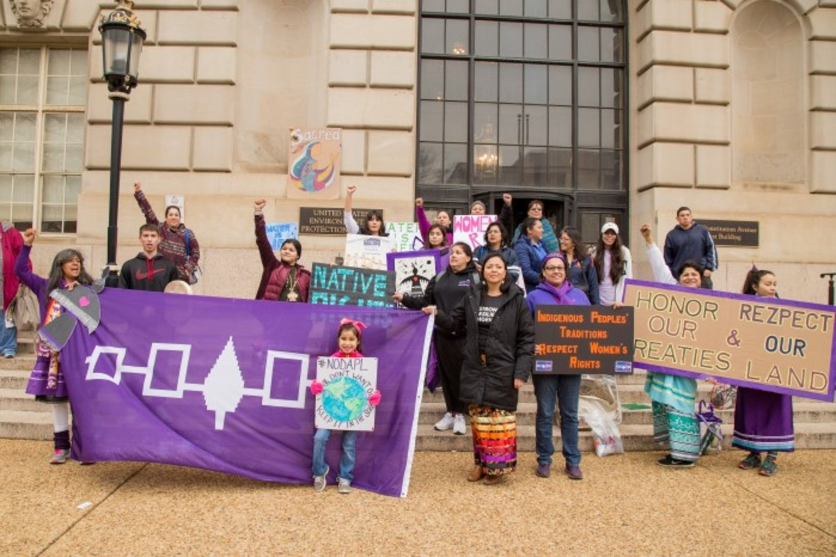 Singing the women's honor song in front of the EPA office. Photo-Alex Hamer