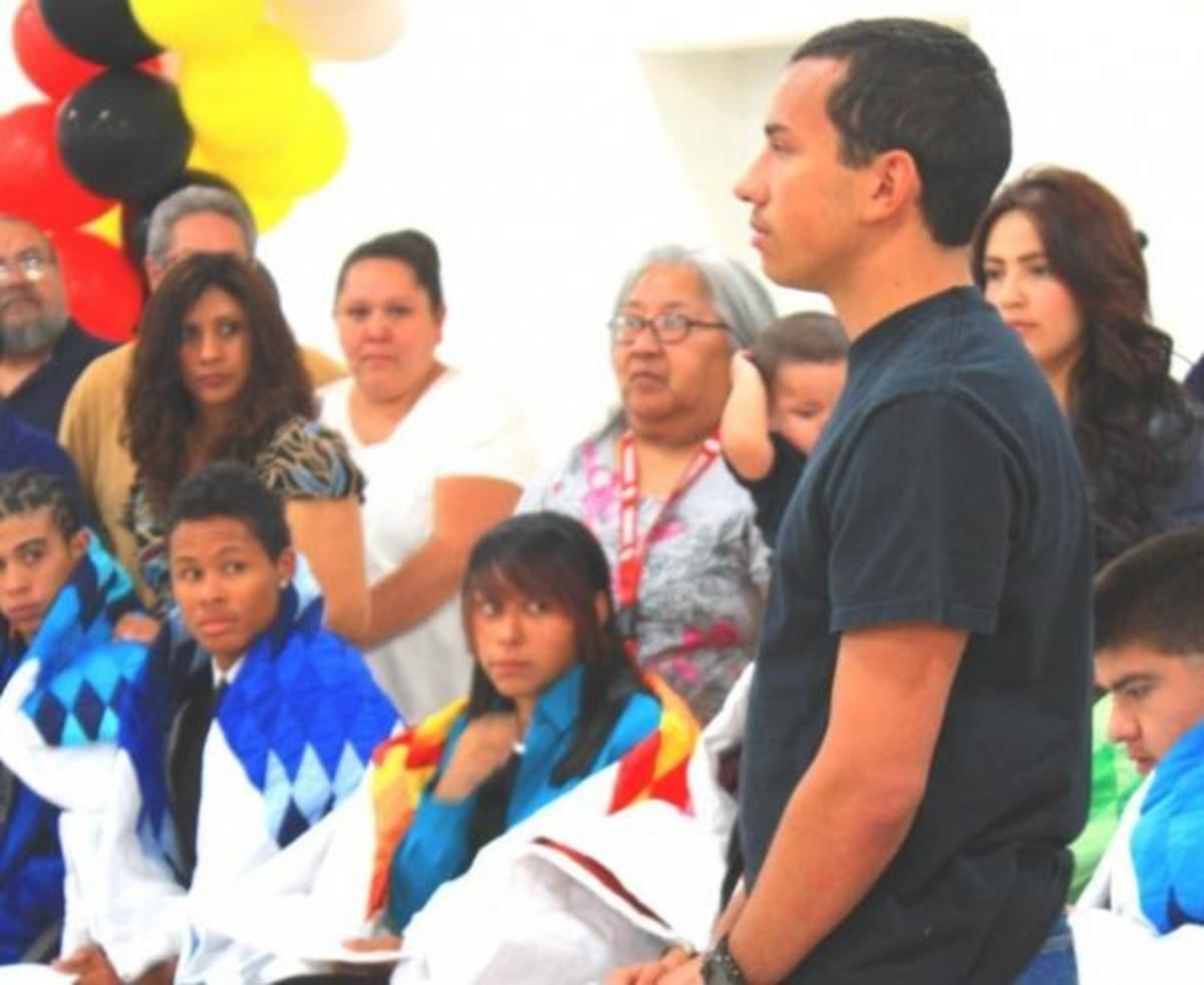 Isaac Anderson, Cherokee/Mohawk/Blackfeet/First Nations, who will be designing hydrogen engines, stood to receive his honoring blanket in a Denver Public Schools event May 3.