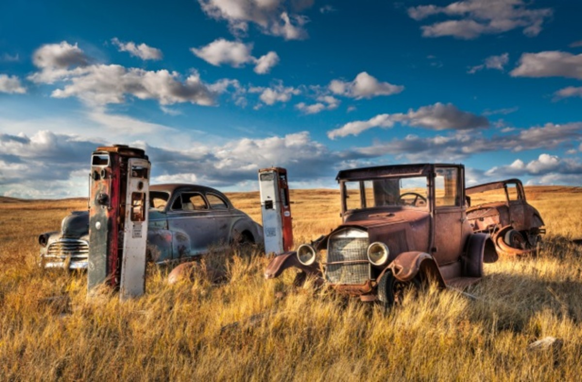 Eclectic collection of old cars and gas pumps on a Cheyenne River ranch.